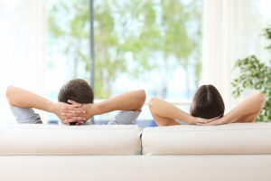 Couple relaxing on a white sofa