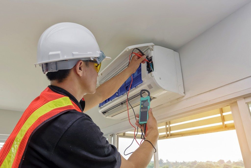 Engineer Repairing Air Conditioner