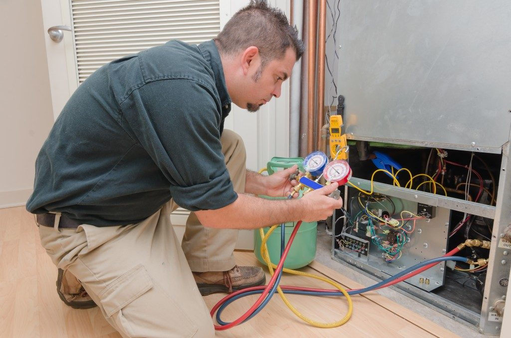 HVAC technician charging a heat pump with refrigerant