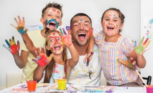 Family covered in paint