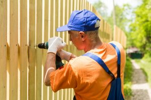 Man installing fence