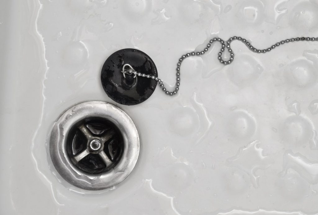 Bathroom drain with rubber stopper