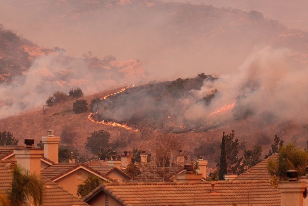 Mountain wildfire near a residential area
