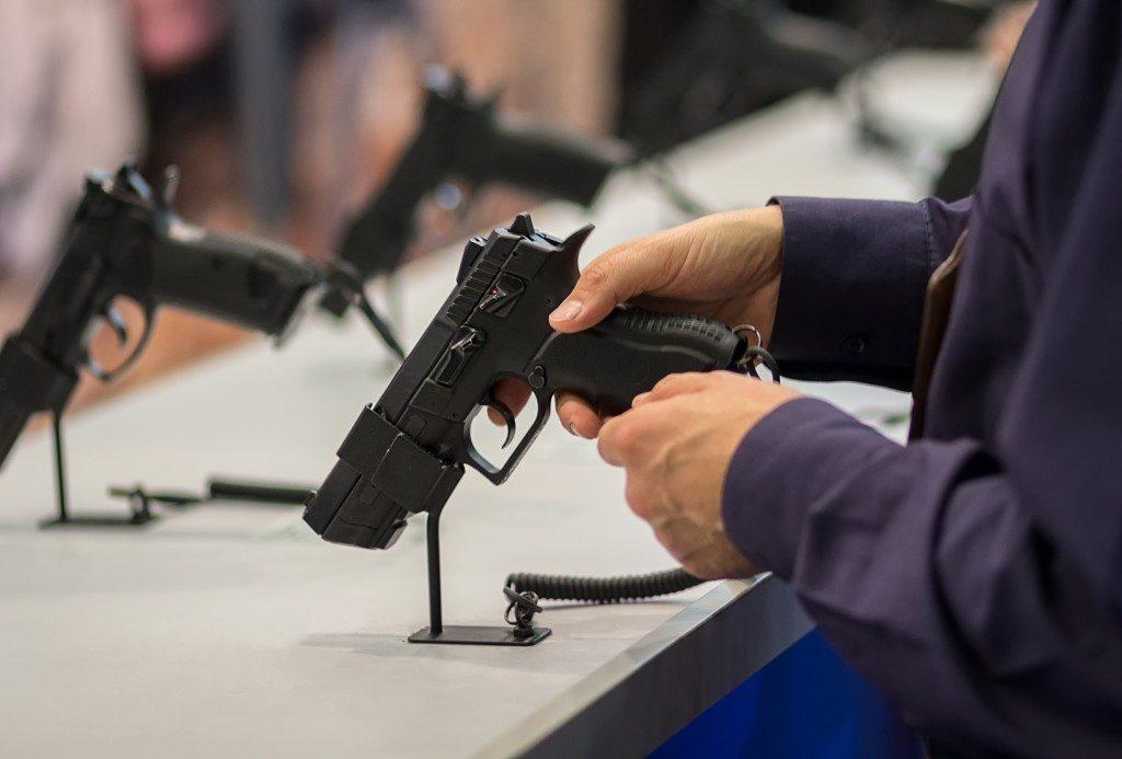 man trying display gun