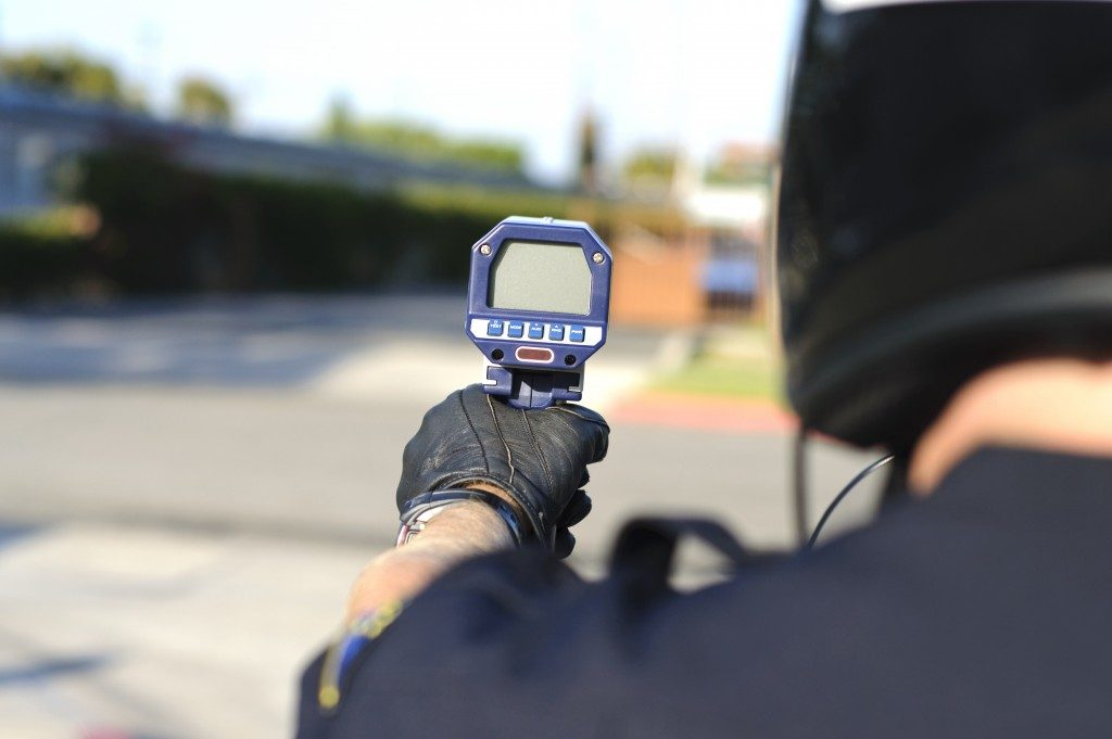 police with radar gun