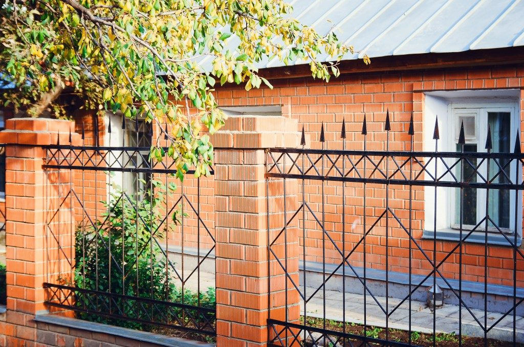 Metal fence with brick columns