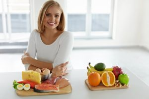 a woman with healthy food