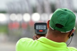 man using radar gun