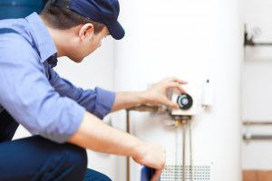 Plumber checking the water heater