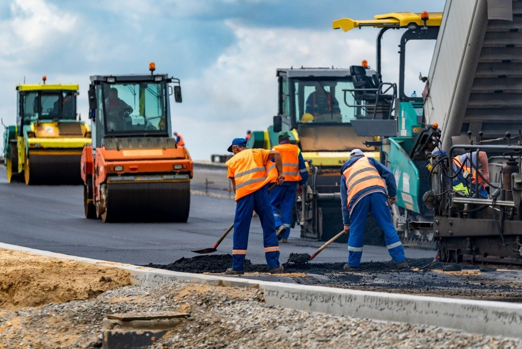 workers applying asphalt