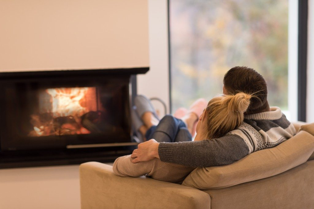 couple in the living room in front of fireplace