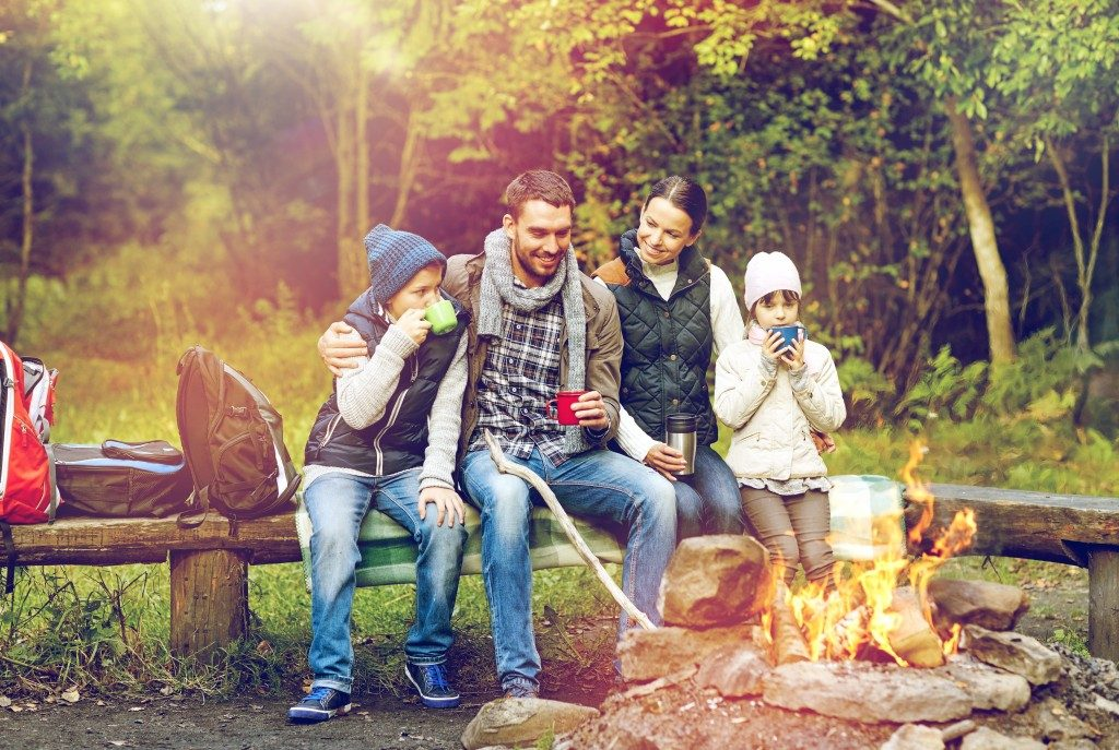 Family in front of a bonfire