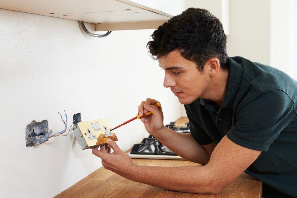 man fixing socket