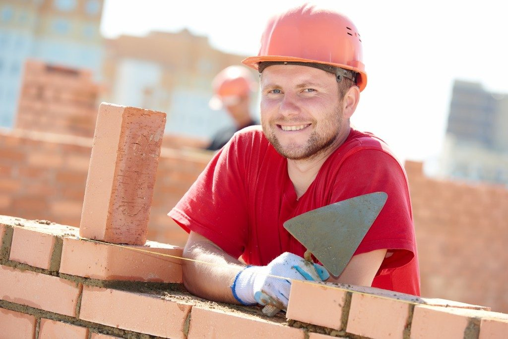construction worker installing bricks