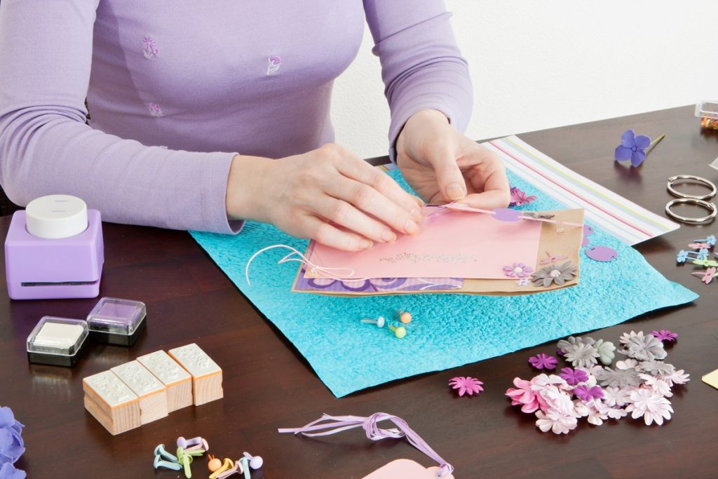woman making scrapbook