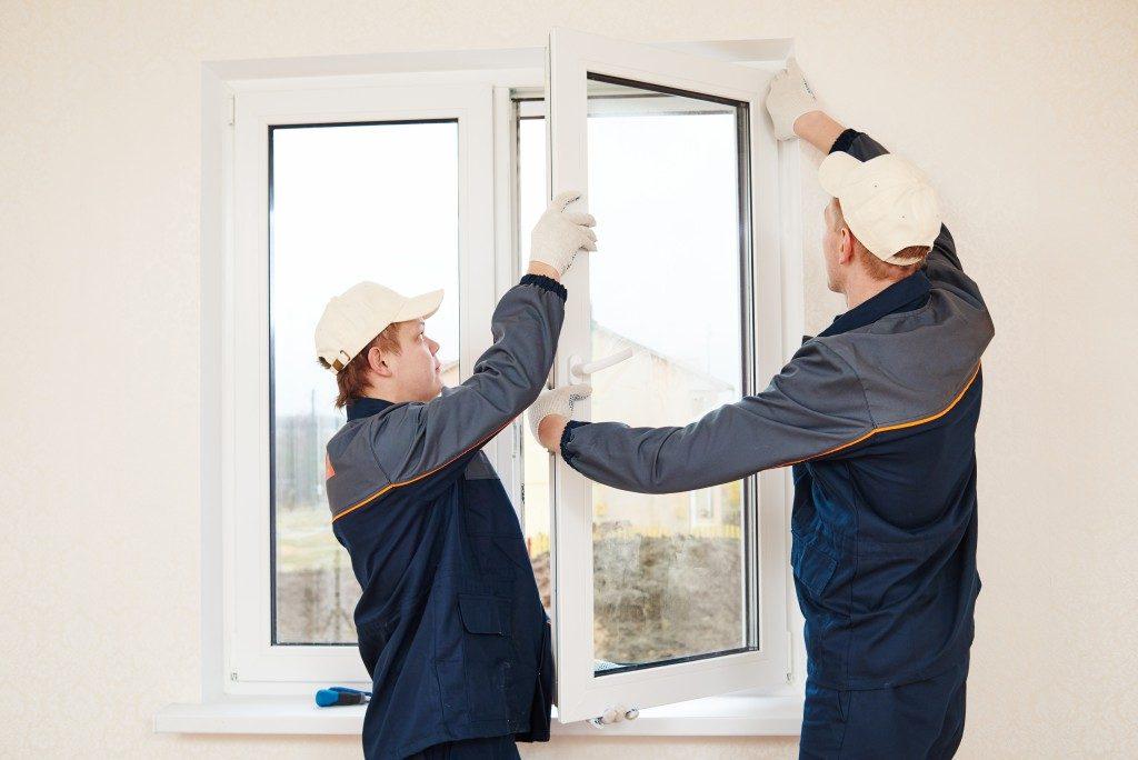 Men installing windows