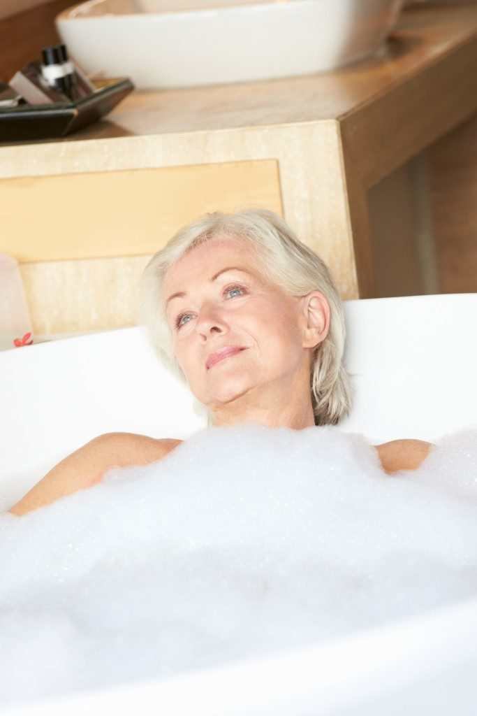 senior woman relaxing in the bathtub