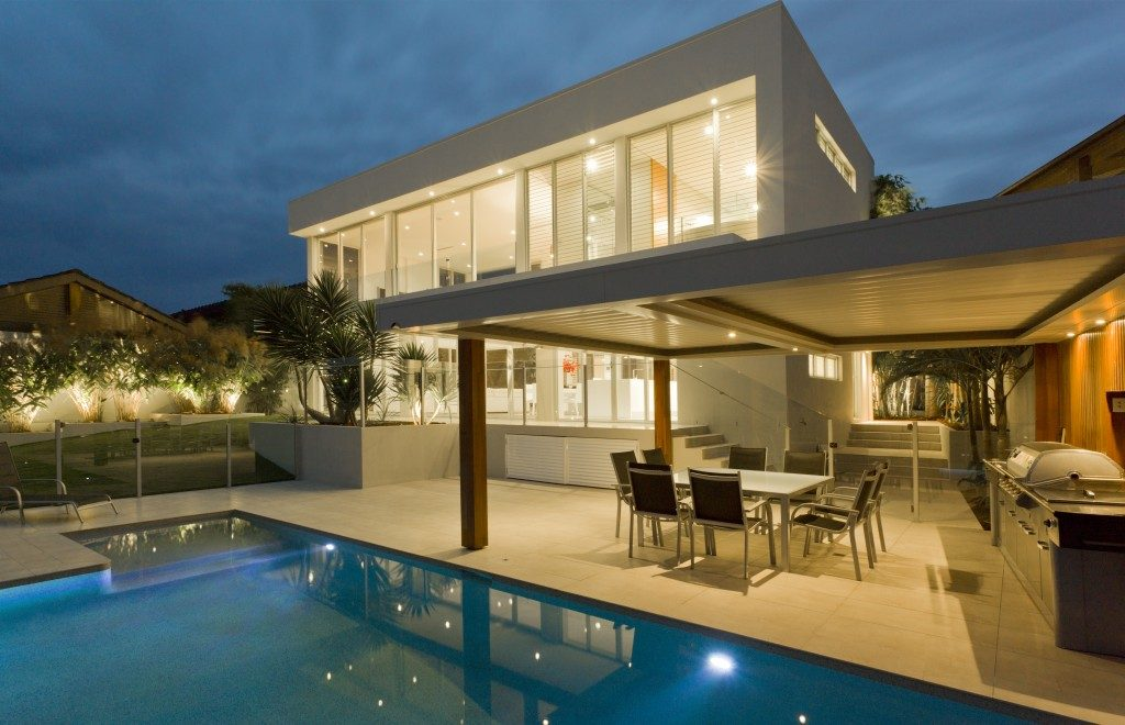 Modern backyard with swimming pool in mansion