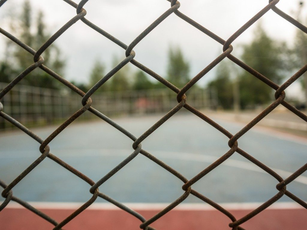 fence around the tennis court