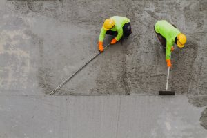 men putting concrete