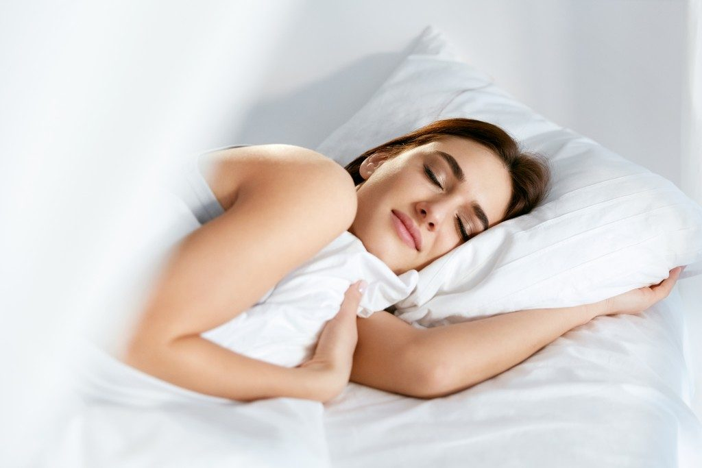 woman comfortable and happy sleeping