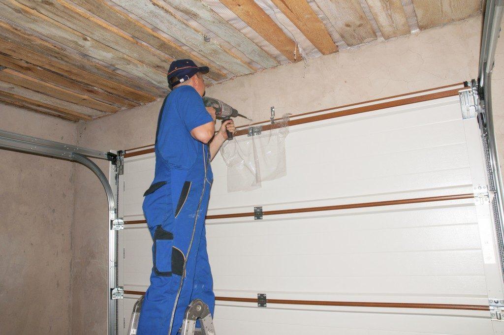 Worker fixing the garage door