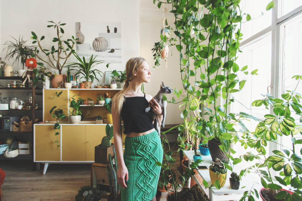 woman surrounded by house plants