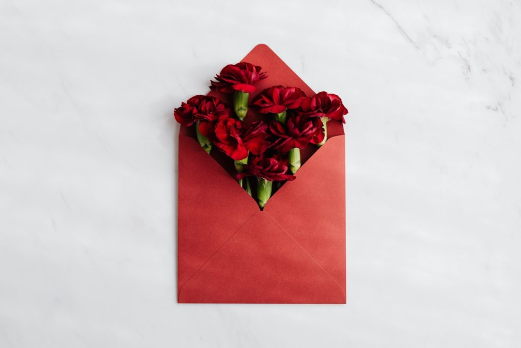 red envelope and roses