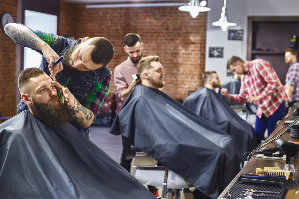 men getting hair cut