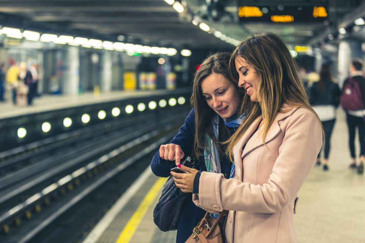 2 women at a train station platform