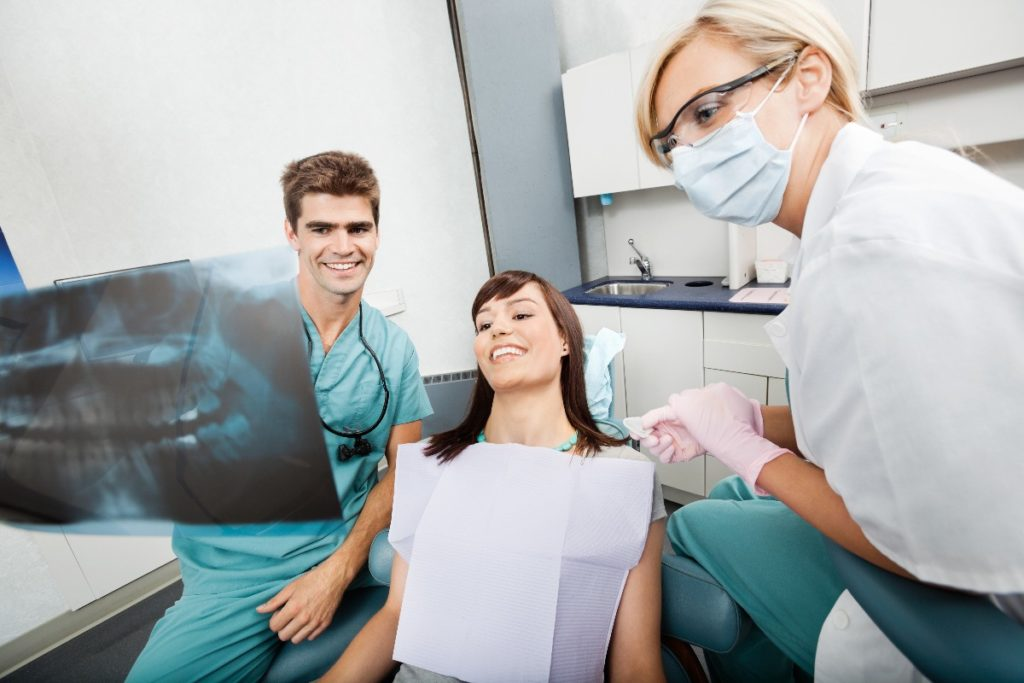 dentists and a patient